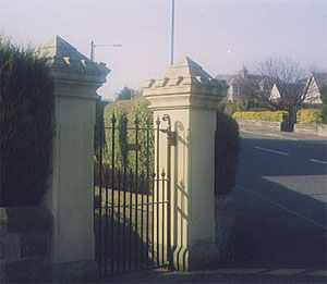 pillars masoned and reinstated in blond sandstone